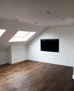 Finished loft conversion with wooden floor